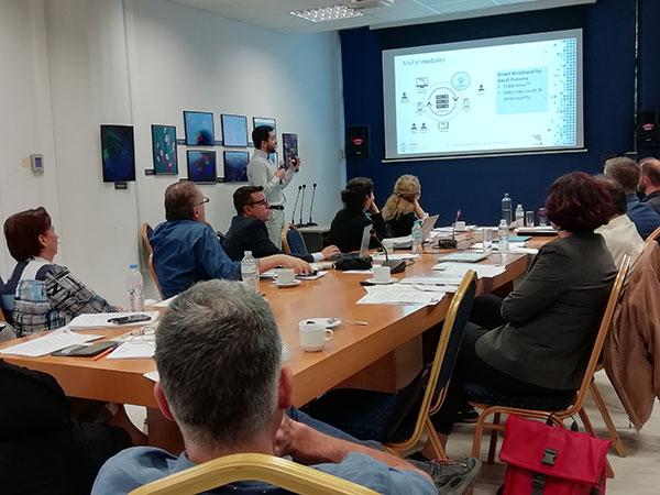 Christos Maramis presenting at a Social Lab meeting